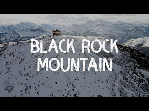 scrambling-black-rock-mountain-in-winter